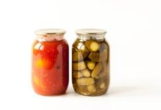 Rimmade tomater och gurkor Arkivfoton