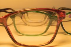 Rimmed eyeglasses closeup on a white background. Abstract view Stock Photos