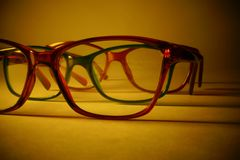 Rimmed eyeglasses closeup on a white background. Abstract view Stock Images