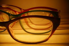 Rimmed eyeglasses closeup on a white background. Abstract view Stock Photography
