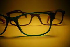 Rimmed eyeglasses closeup on a white background. Abstract view Royalty Free Stock Image