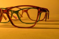 Rimmed eyeglasses closeup on a white background. Abstract view Stock Image