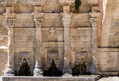 Rimondi Fountain in Rtehymno, Crete island, Greece. Built during Venetian rule of Crete in order to provide free drinking water to the town royalty free stock photo