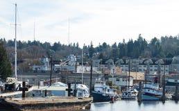 Rimorchiatori dell'annata attraccati in Salmon Bay Seattle Washington fotografia stock libera da diritti