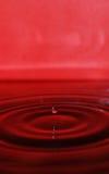 Rimpelingen op rood water Royalty-vrije Stock Afbeelding