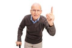 Rimproverare arrabbiato dell'uomo senior Fotografia Stock Libera da Diritti