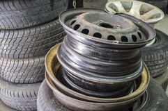 Rims and tyres at garage waiting for repaired Royalty Free Stock Photos