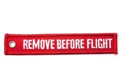 Rimuova prima del distintivo di volo Fotografie Stock Libere da Diritti