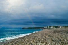 Rinbow por la playa foto de archivo