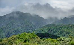 Rincon de la vieja vulcano and misty clouds. Closeup view of rincon de la vieja vulcano and misty clouds Stock Photo