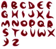 rinda de fuentes rojas del alfabeto de la sangre Foto de archivo