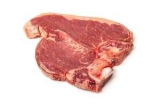 Rindfleischsteak auf Weiß Stockfotos