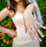 With this Ring... Portrait of a beautiful bride proudly flashing her wedding ring Stock Photo