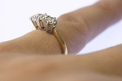 Ring. Diamond ring on finger royalty free stock images