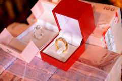 Ring. On money for wedding event Stock Photography