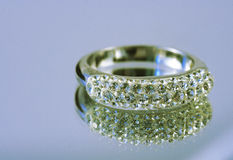 Ring. A silver ring with circonia on a mirror surface stock image