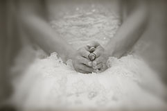 The ring. Bride holding the grooms ring Stock Photo