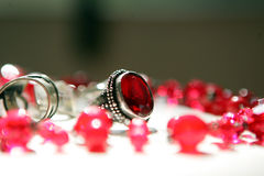 Ring and accessories. Silver Ring with a red ruby and accessories stock photos