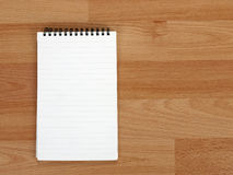 Ring aka spiral bound note pad on desk, blank Royalty Free Stock Image
