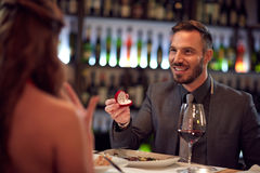 Ring as surprise at dinner in restaurant Stock Images