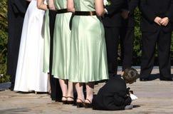 Ring bearer. Wedding ceremony scene of tired ringbearer Royalty Free Stock Images