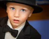 Ring bearer. Little boy dressed up in top hat and tuxedo Stock Photos