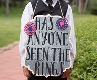 Ring Bearer Holding Sign. Reading: `Has anyone seen the rings Stock Images