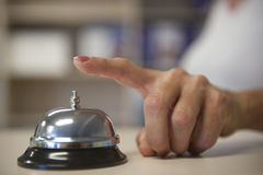 Ring the Bell. Image of finger over a bell on a service deck Stock Images