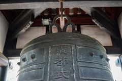 Ring bell in ancient Chinese temple stock photo