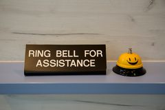 Ring bell for assistance sign stock images