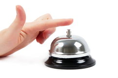Ring bell. With the hand on white Royalty Free Stock Images