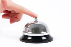 Ring bell. With the hand on white Royalty Free Stock Photography