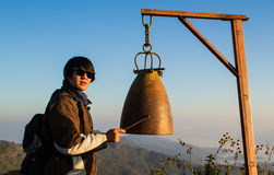 Ring the bell. Ringing the bell on top of the mountain Royalty Free Stock Photography