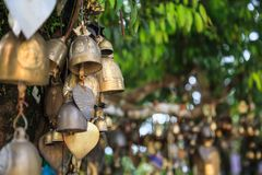 Ring bells in temple. Bell Sound is auspicious which welcome divinity and dispels evil. Bells symbolize wisdom and compassion, whi. Ch Buddhist practitioners stock photo