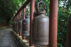 Ring bells in temple. Bell Sound is auspicious which welcome divinity and dispels evil. Bells symbolize wisdom and compassion, whi. Ch Buddhist practitioners stock images
