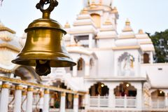 Ring bells in temple. Golden metal bell isolated. Big brass Buddhist bell of Japanese temple. Ringing bell in temple is belief royalty free stock photography