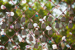 Ring bells, temple of Thailand. Small ring bells of prayer in a Buddhist temple in Thailand Royalty Free Stock Photo