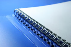 Ring binder. On blue background Royalty Free Stock Photography