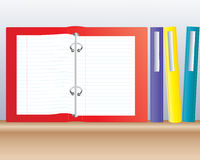 Ring binder. An illustration of colored ring binders on a wooden shelf one open with blank pages of writing paper Stock Photography