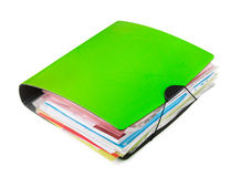 Ring binder. Green ring binder with documents  on white Stock Photo