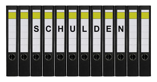 Ring binders. Twelve ring binders labeled SCHULDEN standing side by side Stock Photo