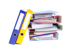 Ring binders. Pile of colorful ring binders over white background stock image