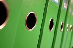 Ring binders. Row of green ring binders Royalty Free Stock Photo