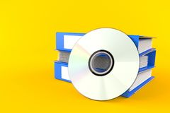Ring binders with cd disc. Isolated on orange background Stock Image