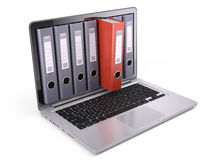Ring binders, file folders inside the screen of laptop  on white. 3d render Royalty Free Stock Photos