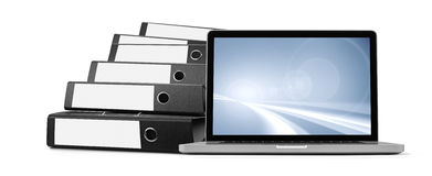 Ring binders and laptop Stock Images