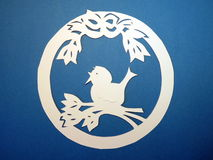 Ring with bird. Paper cutting. Stock Images