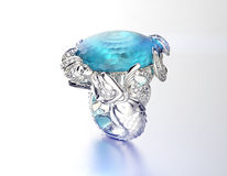 Ring with Blue topaz. Fashion Jewelry background Stock Images