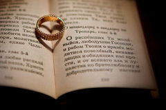 Ring on the book Stock Images