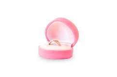 Ring in the box. Gold ring in a pink heart shaped box isolated on white background Royalty Free Stock Photo